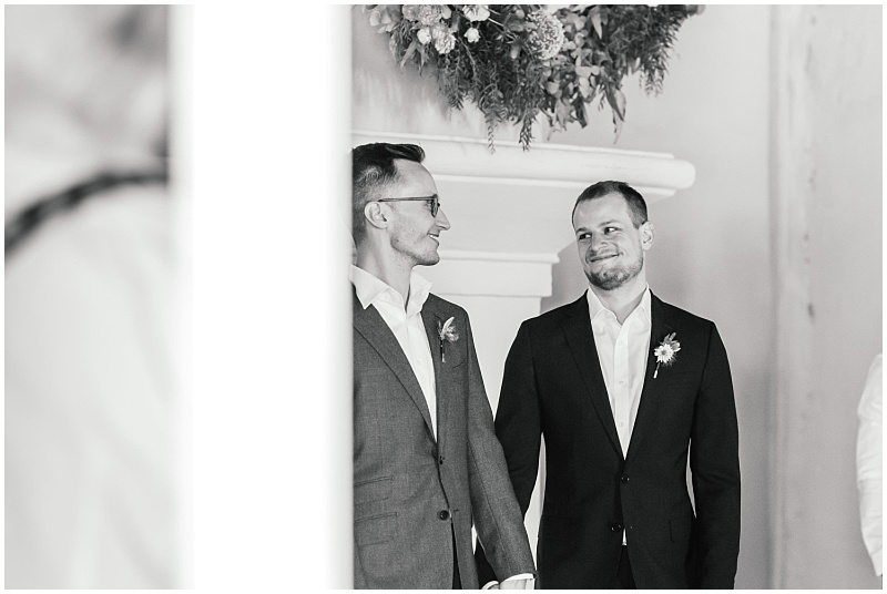 Gay wedding couple at ceremony
