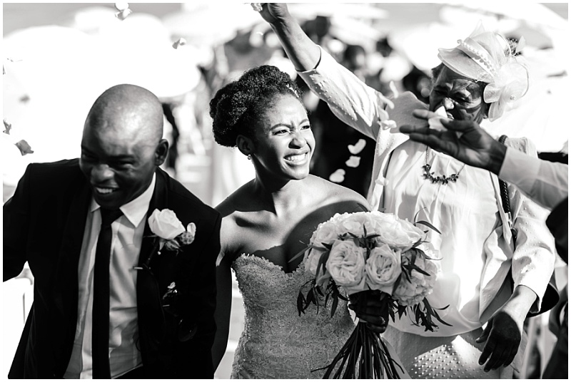 African couple ceremony confetti photo