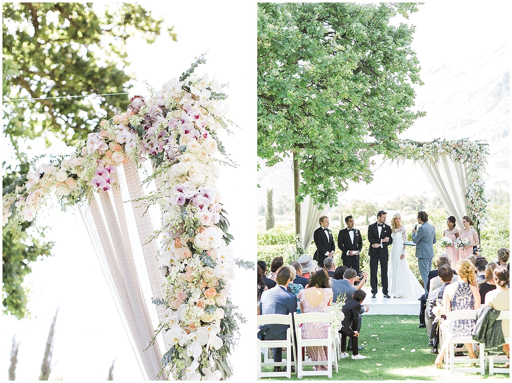 lush wedding arch with draping