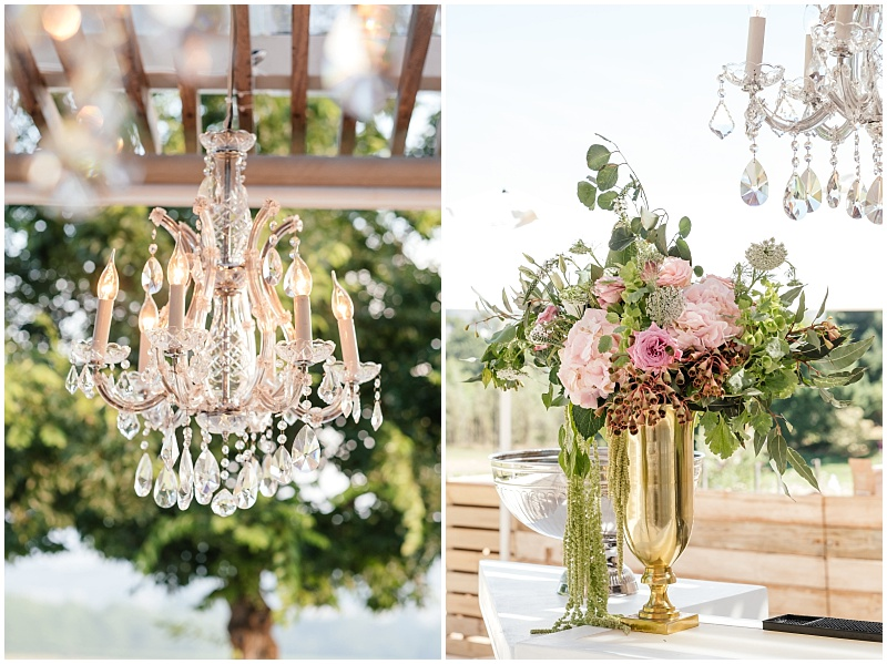 Crystal chandelier and bar floral arrangement