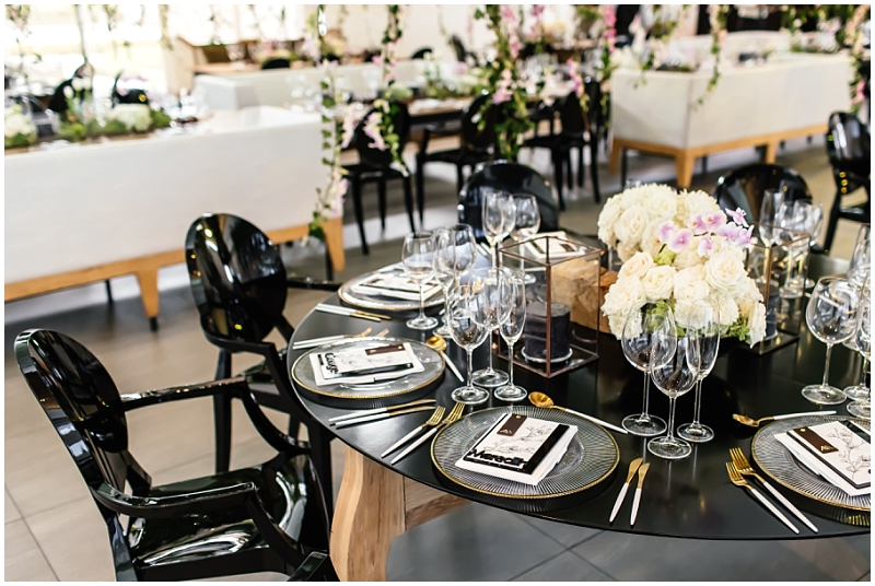 Black ghost chairs and black table tops