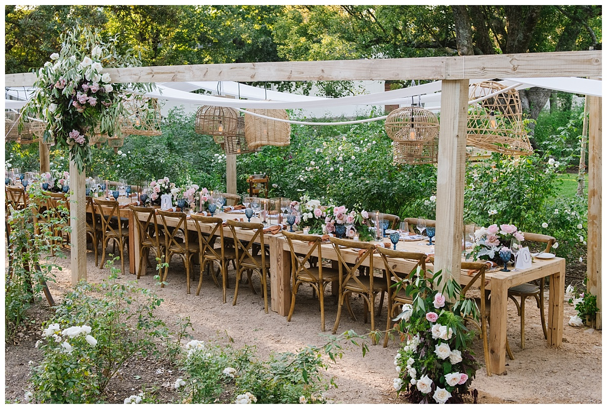 long wooden table at outdoor reception