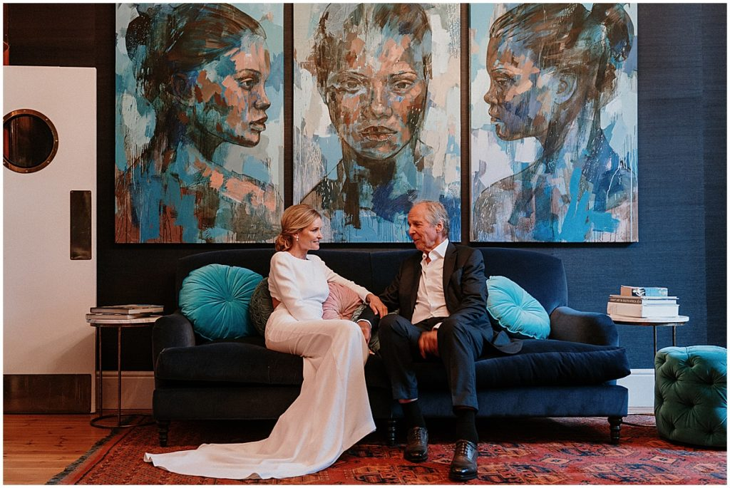 bride and groom portrait blue couch